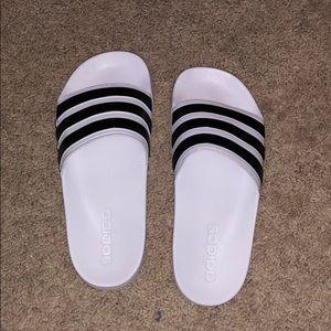 White and black Adidas slides